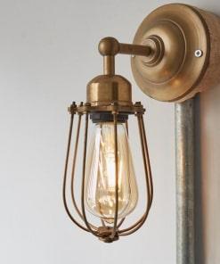Žalvario spalvos sieninis šviestuvas ORLANDO su grotelėmis