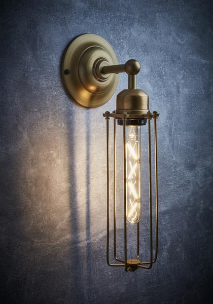 Žalvario spalvos cilindro formos sieninis šviestuvas ORLANDO interjere