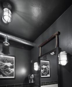 Ovalus sieninis šviestuvas BROOKLYN baro interjere